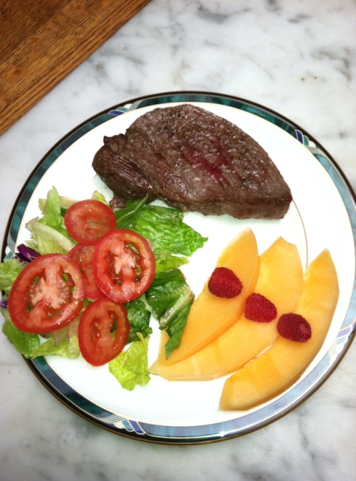 Sirloin steak, salad, cantaloupe, 3 raspberries