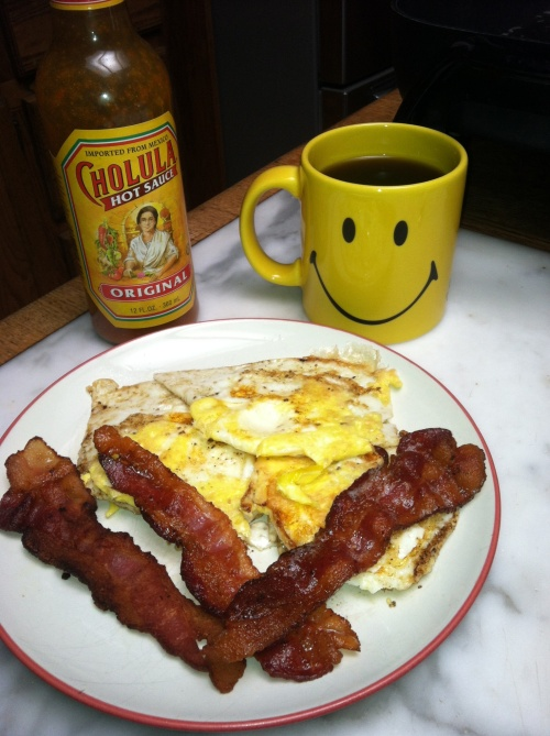 Bacon, eggs, black coffee, and Cholula hot sauce. A caveman wouldn't recognized any of this except for eggs.